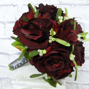 Velvet red rose mistletoe wedding bouquet