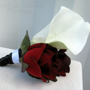 White calla lily red / black bacarra rose boutonniere