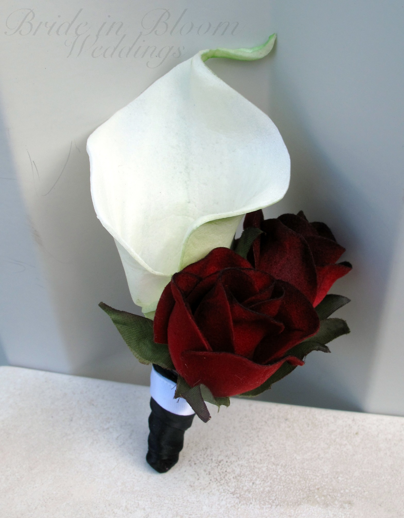 white calla lily red black bacarra rose boutonniere
