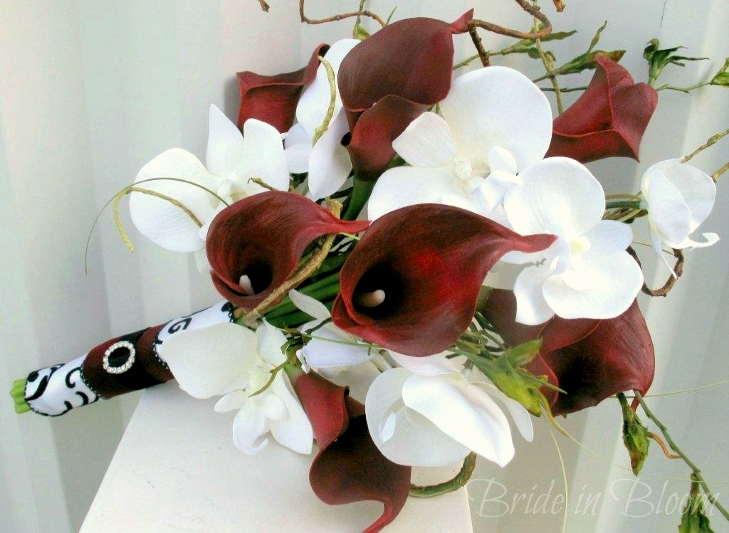 Red calla lily white orchid wedding bouquet bride in bloom