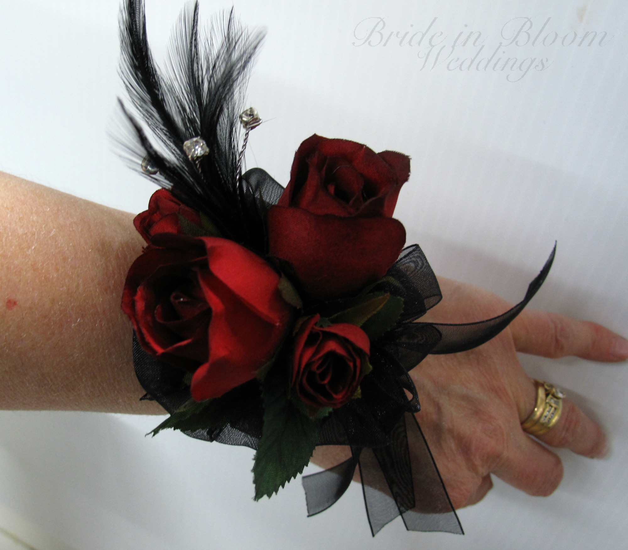 Red black rose wrist corsage | Bride in Bloom