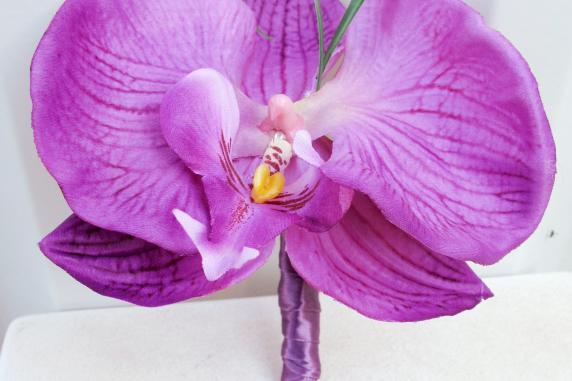 Lavender orchid boutonniere
