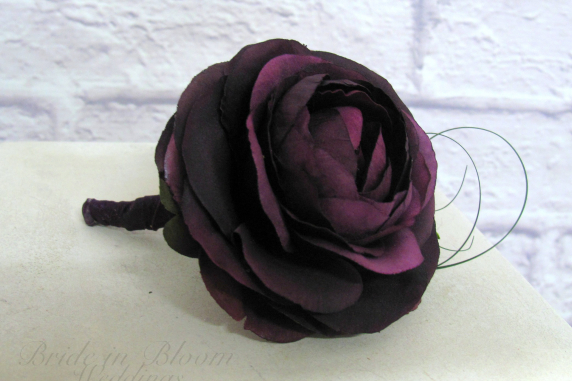Plum purple ranunculus boutonniere