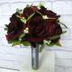 Velvet red rose mistletoe wedding bouquet