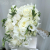 all_white_wedding_bouquet_with_raffia_1.jpg