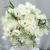 all_white_wedding_bouquet_with_raffia_2.jpg