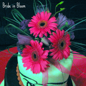 Hot pink gerbera daisy purple cake topper
